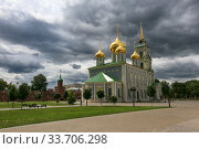 Tula, Russia, June 30, 2016. Beautiful view of the Assumption Cathedral on the territory of the Tula Kremlin on a summer day, golden domes in front of gray clouds. Редакционное фото, фотограф Яна Королёва / Фотобанк Лори