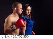 Купить «Boxer hugs slender girl on black background», фото № 33706350, снято 16 ноября 2019 г. (c) Иванов Алексей / Фотобанк Лори