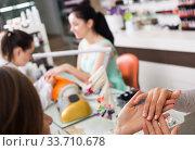 Woman hands receiving manicure. Стоковое фото, фотограф Яков Филимонов / Фотобанк Лори