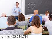 Купить «Confident lecturer talking to mixed age students», фото № 33710710, снято 28 июня 2018 г. (c) Яков Филимонов / Фотобанк Лори