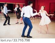Dancing couples enjoying active dance. Стоковое фото, фотограф Яков Филимонов / Фотобанк Лори