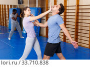 People practicing self defense techniques. Стоковое фото, фотограф Яков Филимонов / Фотобанк Лори