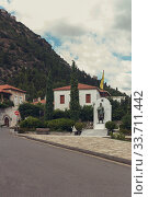 Купить «Street with stone houses and memorial in the village close-up», фото № 33711442, снято 13 сентября 2019 г. (c) Татьяна Ляпи / Фотобанк Лори