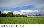 Купить «Beautiful summer rural landscape with cloudy sky», видеоролик № 33711702, снято 18 июля 2018 г. (c) Володина Ольга / Фотобанк Лори