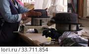 Купить «Mixed race woman working at a hat factory», видеоролик № 33711854, снято 16 мая 2019 г. (c) Wavebreak Media / Фотобанк Лори