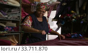 Купить «Mixed race woman working at a hat factory», видеоролик № 33711870, снято 16 мая 2019 г. (c) Wavebreak Media / Фотобанк Лори