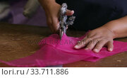 Купить «Mixed race woman working at a hat factory», видеоролик № 33711886, снято 16 мая 2019 г. (c) Wavebreak Media / Фотобанк Лори