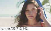 Купить «Caucasian woman ready to go surf », видеоролик № 33712142, снято 25 февраля 2020 г. (c) Wavebreak Media / Фотобанк Лори