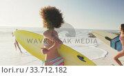 Купить «Mixed race women ready to go surf », видеоролик № 33712182, снято 25 февраля 2020 г. (c) Wavebreak Media / Фотобанк Лори