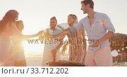Купить «Friends enjoying a party on the beach », видеоролик № 33712202, снято 25 февраля 2020 г. (c) Wavebreak Media / Фотобанк Лори