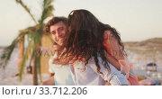 Купить «Caucasian couple enjoying a party on the beach », видеоролик № 33712206, снято 25 февраля 2020 г. (c) Wavebreak Media / Фотобанк Лори