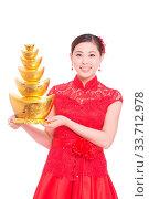 Купить «Young asian woman in red cheongsam holds gold ingot in chinese new year», фото № 33712978, снято 14 июля 2020 г. (c) age Fotostock / Фотобанк Лори