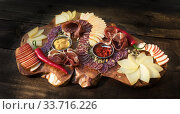 Spanish tapas. Beautifully Served Sliced Salami, Jamon, Prosciutto, Cheese, Apple with Sauces. Стоковое фото, фотограф Ирина Кожемякина / Фотобанк Лори