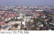 Купить «Aerial view of historic part of Lublin overlooking Catholic Archcathedral and Crown Tribunal in Old Town Market, Poland», видеоролик № 33716366, снято 10 марта 2020 г. (c) Яков Филимонов / Фотобанк Лори