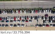 Купить «Top view of wide road with markings and lots of cars at day», видеоролик № 33716394, снято 4 октября 2019 г. (c) Яков Филимонов / Фотобанк Лори