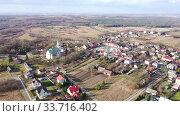 Купить «Aerial view of houses and nature of Wlodowice, located in Poland», видеоролик № 33716402, снято 13 марта 2020 г. (c) Яков Филимонов / Фотобанк Лори