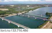 Купить «Panoramic view of suspension bridge Pont de Roquemaure, Rhone road bridge and railway Viaduc de Roquemaure across Rhone river, France», видеоролик № 33716486, снято 30 августа 2019 г. (c) Яков Филимонов / Фотобанк Лори