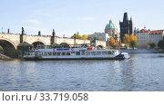 View of Charles bridge in autumn sunny day. Prague. Czech republic. Редакционное видео, видеограф Яков Филимонов / Фотобанк Лори