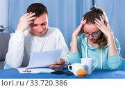 Купить «Couple struggling to pay bills», фото № 33720386, снято 18 марта 2017 г. (c) Яков Филимонов / Фотобанк Лори