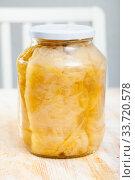 Купить «Homemade sauerkraut in glass jar», фото № 33720578, снято 6 июня 2020 г. (c) Яков Филимонов / Фотобанк Лори