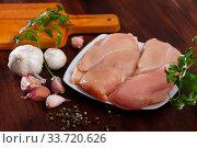 Raw chicken breast on wooden table. Стоковое фото, фотограф Яков Филимонов / Фотобанк Лори
