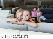 Sisters which are happy of the purchase of a new sofa. Стоковое фото, фотограф Яков Филимонов / Фотобанк Лори