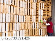 African-american man works in warehouse. Стоковое фото, фотограф Яков Филимонов / Фотобанк Лори