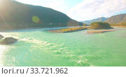 Купить «Low altitude flight over fresh fast mountain river with rocks at sunny summer morning.», видеоролик № 33721962, снято 25 марта 2019 г. (c) Александр Маркин / Фотобанк Лори