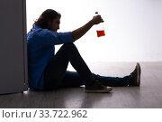Купить «Young man suffering from alcoholism», фото № 33722962, снято 10 сентября 2019 г. (c) Elnur / Фотобанк Лори