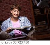 Купить «Young handsome student preparing for exams at night», фото № 33723450, снято 28 августа 2018 г. (c) Elnur / Фотобанк Лори