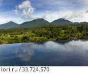 View of the tropical nature and mountains and the pool in the foreground. Baturiti Tabanan, Bali (2020 год). Стоковое фото, фотограф Куликов Константин / Фотобанк Лори