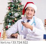 Купить «Doctor on the shift on christmas eve», фото № 33724922, снято 18 июля 2018 г. (c) Elnur / Фотобанк Лори