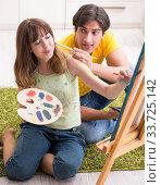 Купить «Young couple enjoying painting at home», фото № 33725142, снято 11 июля 2018 г. (c) Elnur / Фотобанк Лори