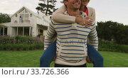 Купить «Caucasian couple spending time in a garden », видеоролик № 33726366, снято 28 ноября 2019 г. (c) Wavebreak Media / Фотобанк Лори