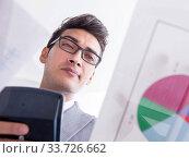 Купить «Businessman looking at financial charts and graphs», фото № 33726662, снято 9 сентября 2017 г. (c) Elnur / Фотобанк Лори