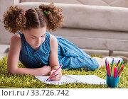 Купить «Young little girl drawing on paper with pencils», фото № 33726742, снято 24 июня 2017 г. (c) Elnur / Фотобанк Лори
