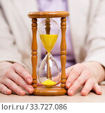 Купить «Hourglasses in business concept in time concept», фото № 33727086, снято 14 мая 2016 г. (c) Elnur / Фотобанк Лори