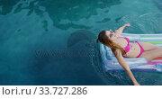 Купить «Caucasian woman enjoying the pool during a sunny day», видеоролик № 33727286, снято 28 ноября 2019 г. (c) Wavebreak Media / Фотобанк Лори
