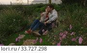 Купить «Caucasian couple spending time in a garden », видеоролик № 33727298, снято 28 ноября 2019 г. (c) Wavebreak Media / Фотобанк Лори