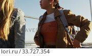 Купить «Side view of a Caucasian and a mixed race girl hanging out together», видеоролик № 33727354, снято 9 августа 2019 г. (c) Wavebreak Media / Фотобанк Лори