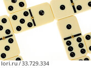 Close up of domino on a white background. Стоковое фото, фотограф Zoonar.com/Micha Klootwijk / age Fotostock / Фотобанк Лори