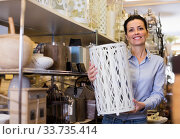 Woman holding item for her home in decor furnishings shop. Стоковое фото, фотограф Яков Филимонов / Фотобанк Лори