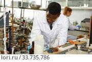 Купить «Lab scientist performing experiments in laboratory, writing results», фото № 33735786, снято 21 марта 2019 г. (c) Яков Филимонов / Фотобанк Лори