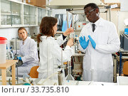 Купить «Lab scientists discussing about results of experiments in laboratory», фото № 33735810, снято 21 марта 2019 г. (c) Яков Филимонов / Фотобанк Лори