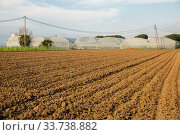 Купить «Ploughed farm field», фото № 33738882, снято 10 июля 2020 г. (c) Яков Филимонов / Фотобанк Лори