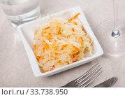 Купить «Plate with appetizing sauerkraut. Traditional russian dish», фото № 33738950, снято 6 июня 2020 г. (c) Яков Филимонов / Фотобанк Лори