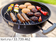barbecue kebab meat and vegetables on grill. Стоковое фото, фотограф Syda Productions / Фотобанк Лори
