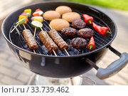 Купить «barbecue kebab meat and vegetables on grill», фото № 33739462, снято 19 сентября 2019 г. (c) Syda Productions / Фотобанк Лори
