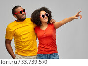 happy african couple in heart shaped sunglasses. Стоковое фото, фотограф Syda Productions / Фотобанк Лори