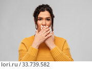 scared woman clothing her mouth with hands. Стоковое фото, фотограф Syda Productions / Фотобанк Лори